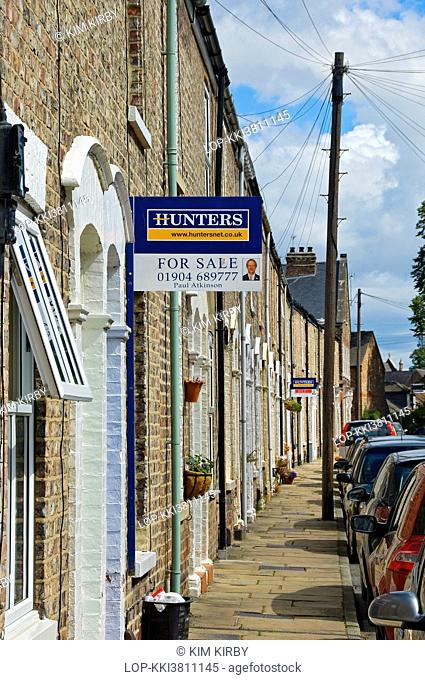 England, North Yorkshire, York. For Sale sign on a terraced house