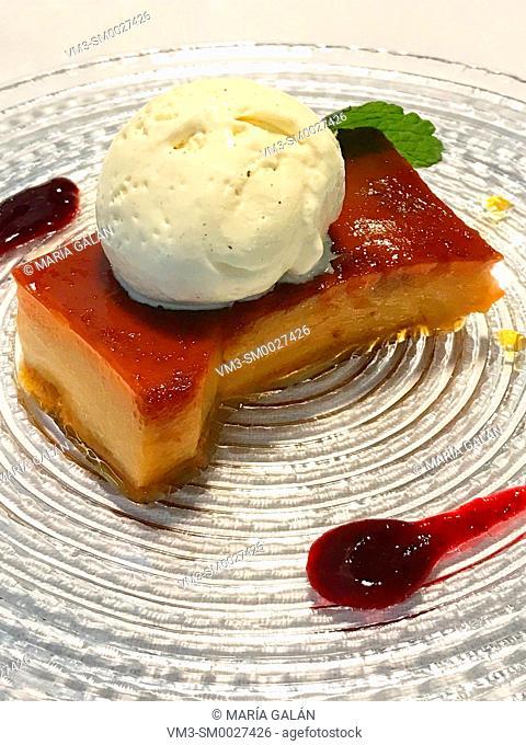 Tocino de cielo with ice cream and strawberry jam