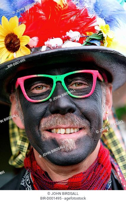 Portrait of Morris dancer wearing costume and makeup smiling