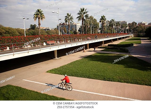 View to the Puente de las Flores in the city center with a cyclist in the foreground, Valencia, Spain, Europe