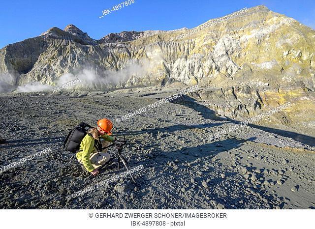 Camerawoman on the volcanic island White Island, Whakaari, Bay of Plenty, North Island, New Zealand