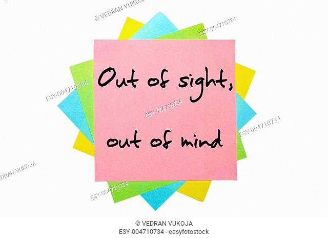 Proverb Out of sight, out of mind written on bunch of sticky