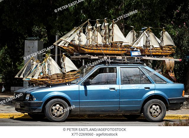 Model sailing ships for sale atop a car in the town of Kalamata, Messenia, Peloponnese, Greece