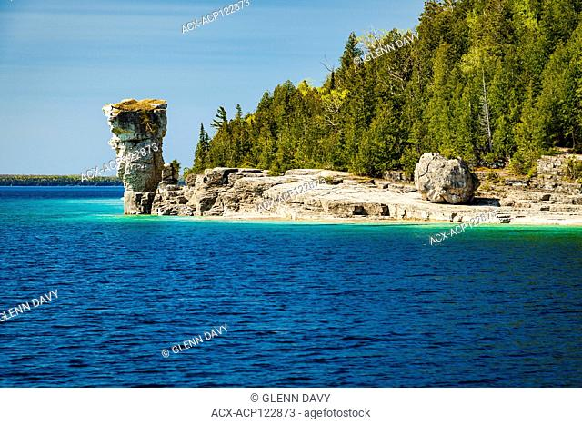 Large 'flowerpot' (sea stack) as seen from the water, Flowerpot Island, Fathom Five National Marine Park, Ontario, Canada