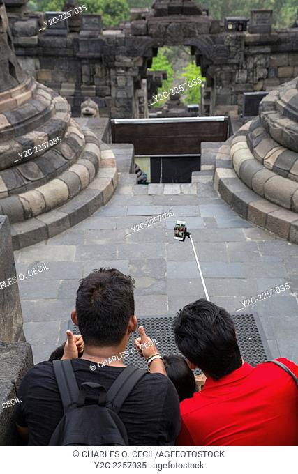 Borobudur, Java, Indonesia. Four Young Indonesians Using an Extension Pole to Take a Selfie while Visiting the Temple