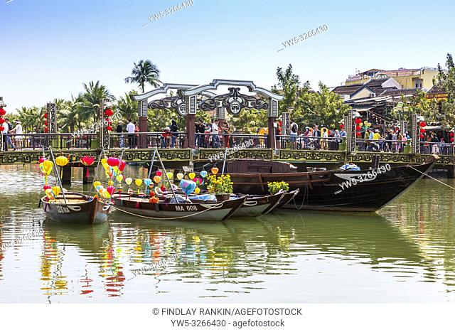 An Hoi bridge over the Son Thu Bon river in , Hoi An, Quang Nam Provence, Vietnam, Asia with lantern boats tied up at the parapit