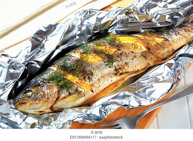Trout stuffed with lemon and dill, baked in tin foil