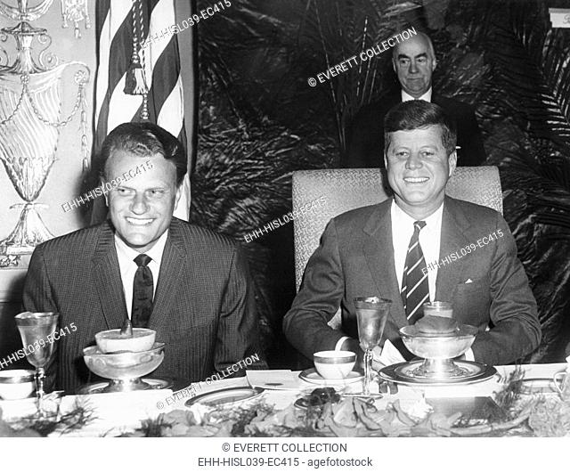 Reverend Billy Graham and President John Kennedy seated at a Prayer Breakfast. It was sponsored by the International Council for Christian Leadership
