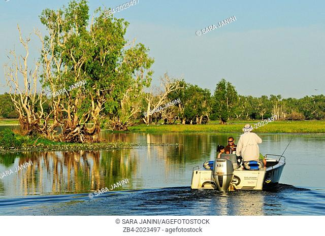 Fishing boat at sunrise, Yellow Water Billabong located at the end of Jim Jim Creek, a tributary of the South Alligator River, Kakadu National Park