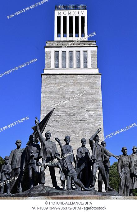 12 September 2018, Thuringia, Weimar: The sculpture of the Buchenwald prisoners by Fritz Cremer (1906-1993) can be seen in front of the bell tower