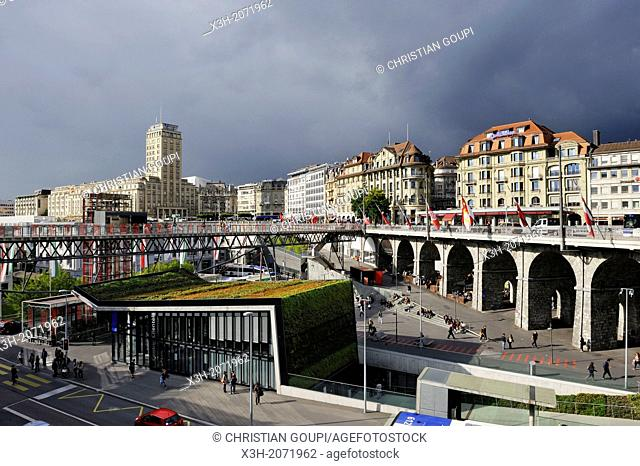 Subway station, Grand-Pont, elevator and footbridge in Le Flon district with the Bel-Air Tower in background, Lausanne, Canton of Vaud, Switzerland, Europe