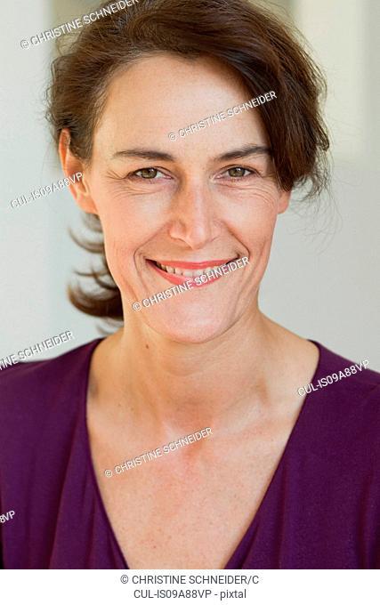 Portrait of woman wearing purple top