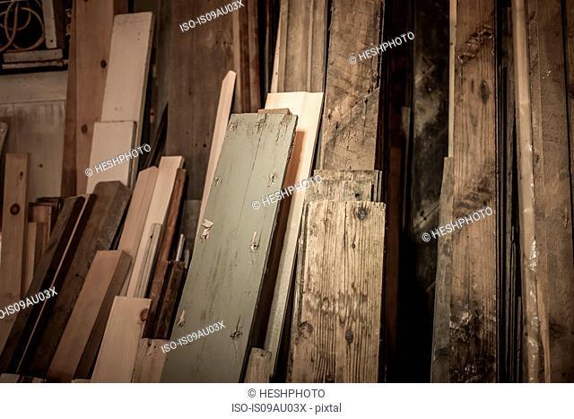 Wood stacked together in artist's workshop