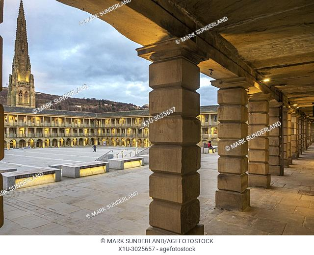 Lights coming on at dusk at the Piece Hall Halifax West Yorkshire England