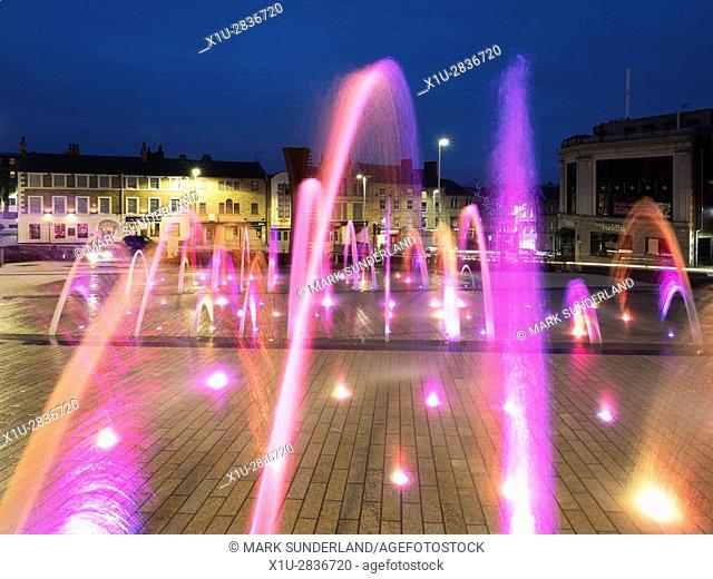 Illuminated Fountain in Barnsley Pals Centenary Square at Dusk Barnsley South Yorkshire England