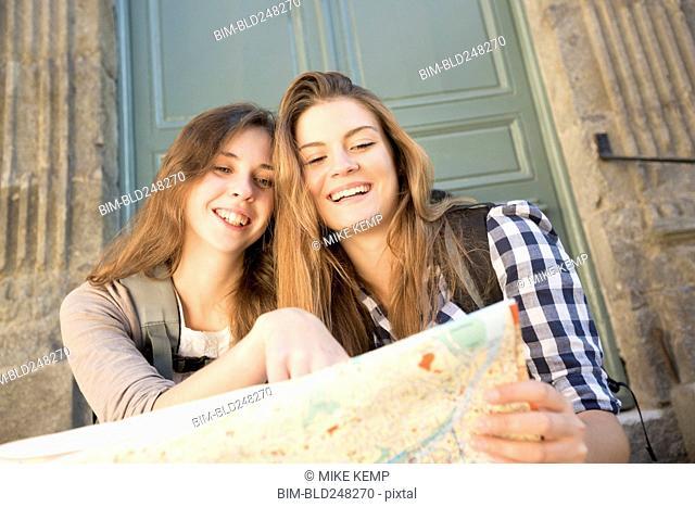 Caucasian women reading map