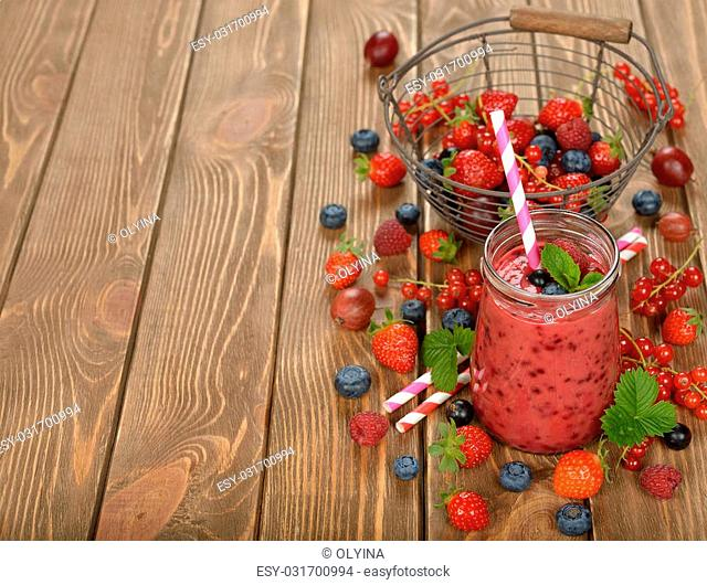 Dietary berry smoothies on a brown background