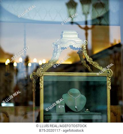 a jewelry showcase with reflections in the glass in place Vendôme Paris France