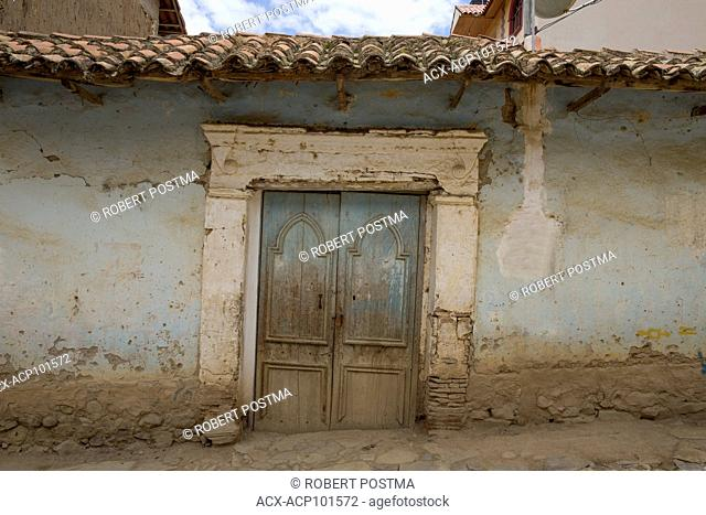 Old door and tile roof in the town of Toro Toro, Bolivia