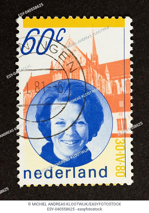 HOLLAND - CIRCA 1980: Stamp printed in the Netherlands shows a picture of the dutch queen (Beatrix), circa 1980