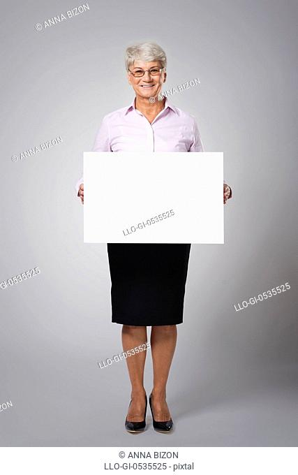 Senior business woman with empty whiteboard. Debica, Poland