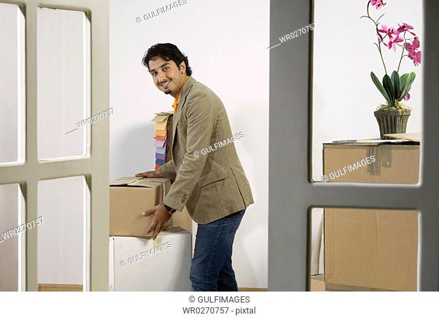 Young Man moving into a new home