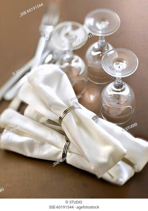 Napkins with napkin rings,glasses and cutlery