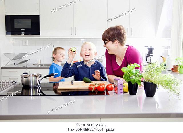 Boys preparing food in kitchen