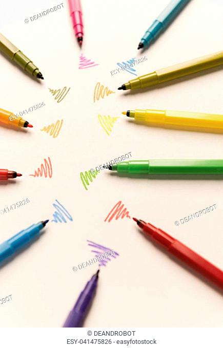 Strokes painted with colorful markers on white paper. Markers sending out wi-fi