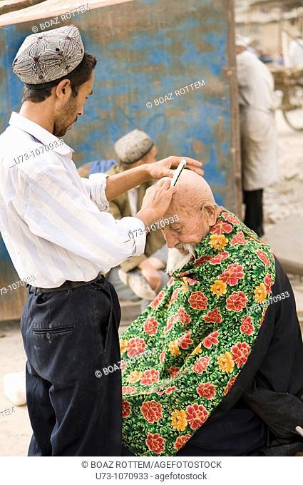Haircut on market day, Kashgar, China