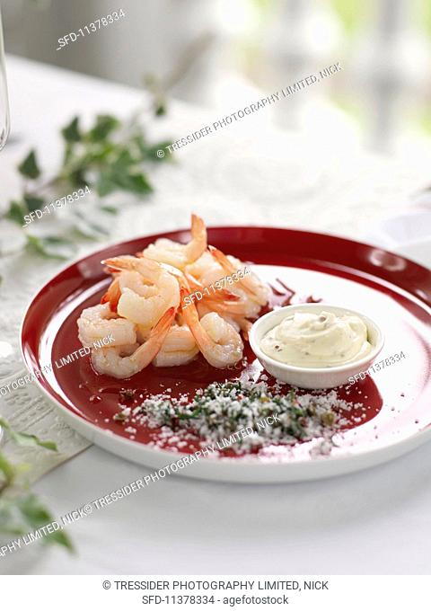A prawn with a dip and herb salt