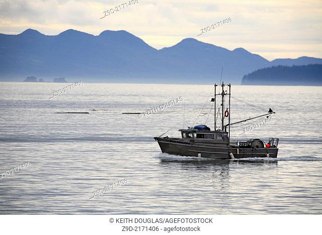 Commercial fishing gillnetter heading to fishing grounds, Prince Rupert, British Columbia