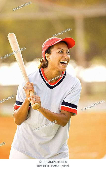 African American woman playing baseball