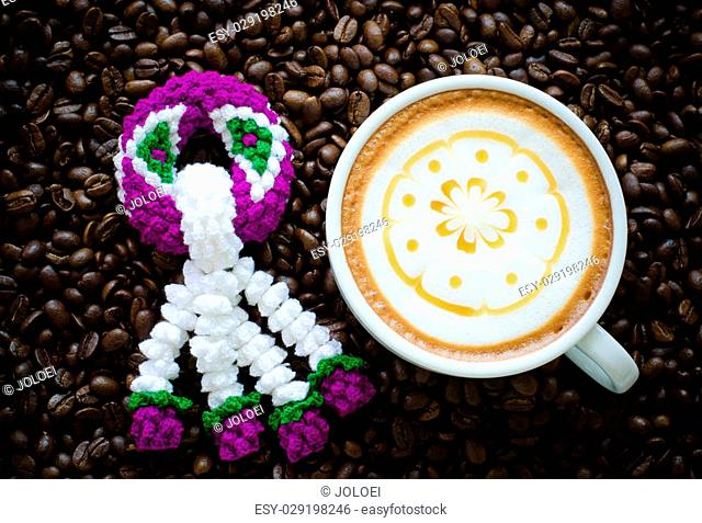 garland knitting and latte art on coffee bean background