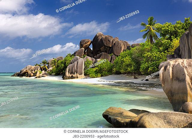Famous beach Anse Source d'Argent with palm trees and sculpted rocks, La Digue Island, Seychelles, Indian Ocean