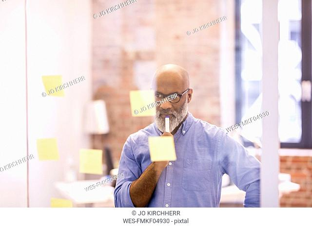 Portrait of pensive businessman in an office