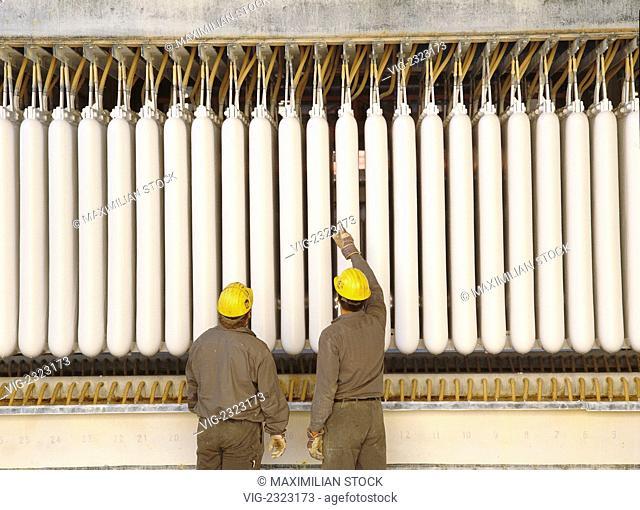 Technicians checking manufacture of the paint pigment titanium white, - 01/01/2010