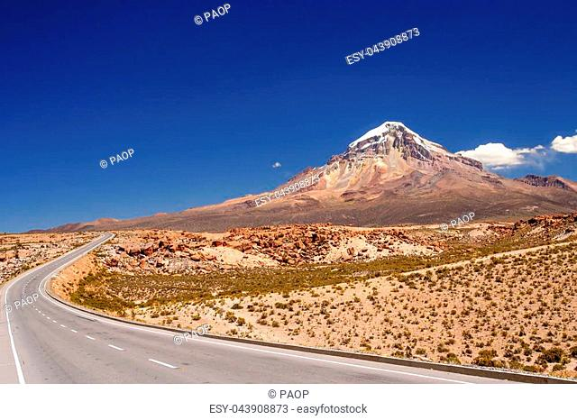 Beautiful road at the foot of the Nevado Sajama volcano in the National Park in Bolivia