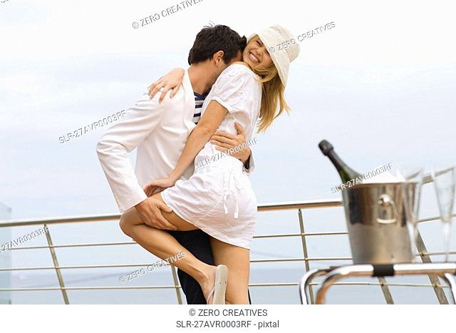 Couple standing at railing