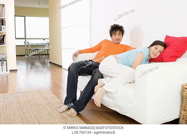 couple relax on the sofa