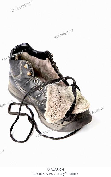 Old winter boot with lace isolated on a white background