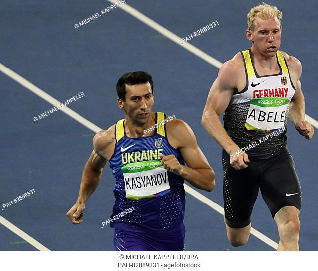 Oleksiy Kasyanov (L) of Ukraine and Arthur Abele of Germany compete in Men's Decathlon 400m running of the Athletic, Track and Field events during the Rio 2016...