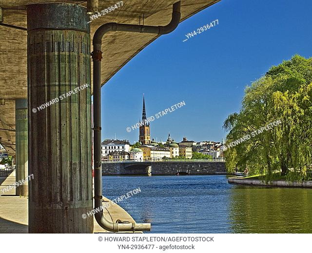 A canal in Stockholm, Sweden. The Riddarholmen church is in the distance