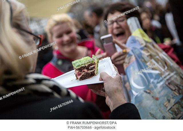 Visitors laugh because they got a slice of the birthday cake during the anniversary celebrations in Frankfurt a.M., Germany, 15 March 2015