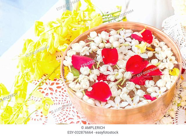 Water in bowl mixed with perfume and flowers, Songkran festival in Thailand