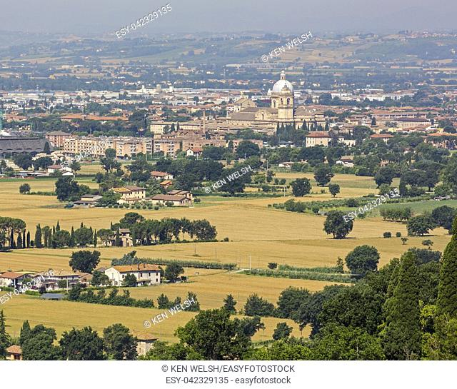 Assisi, Perugia Province, Umbria, Italy. The Papal Basilica of Santa Maria degli Angelior Saint Mary of the Angels seen across the plain in front of Assisi