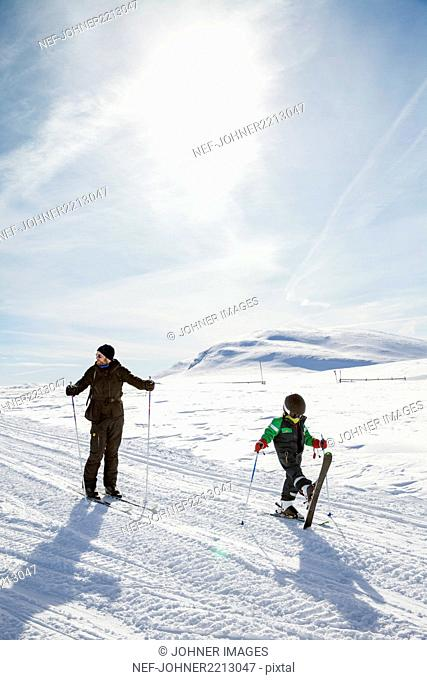 Mother with child skiing