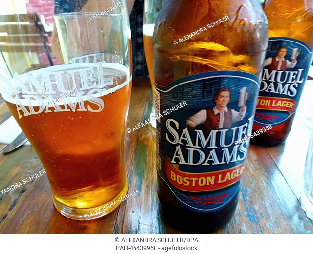 A glass and bottles of the beer brand Samuel Adams stand on a table in New York, USA, 18 August 2014. The lager is brewed by US brewery Boston Beer Company