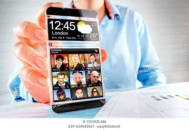 Futuristic Smart phone (phablet) with a transparent display in human hands. Concept actual future innovative ideas and best technologies humanity