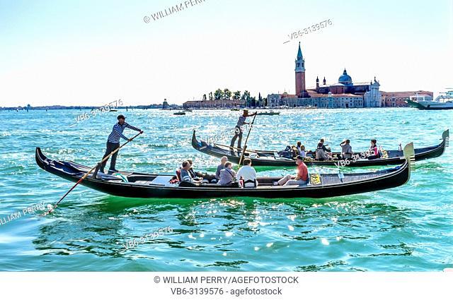 Gondolas Tourists San Giorgio Maggiore Church Grand Canal Boats Venice Italy. 16th Century Benedictine Church on Island Venice Lagoon